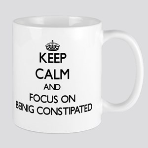 Keep Calm and focus on Beinig Constipated Mugs