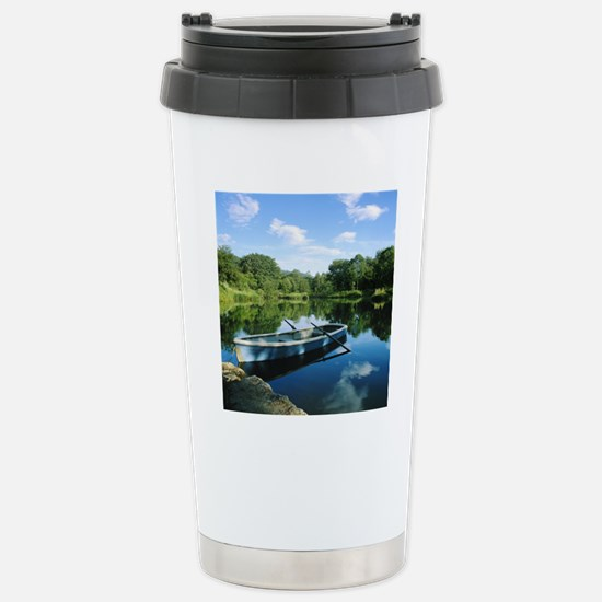 Row boat in pond Stainless Steel Travel Mug