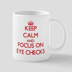 Keep Calm and focus on EYE CHECKS Mugs