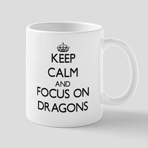 Keep Calm and focus on Dragons Mugs