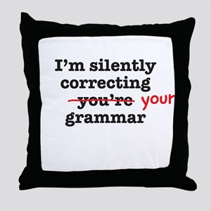 Silently correcting grammar Throw Pillow