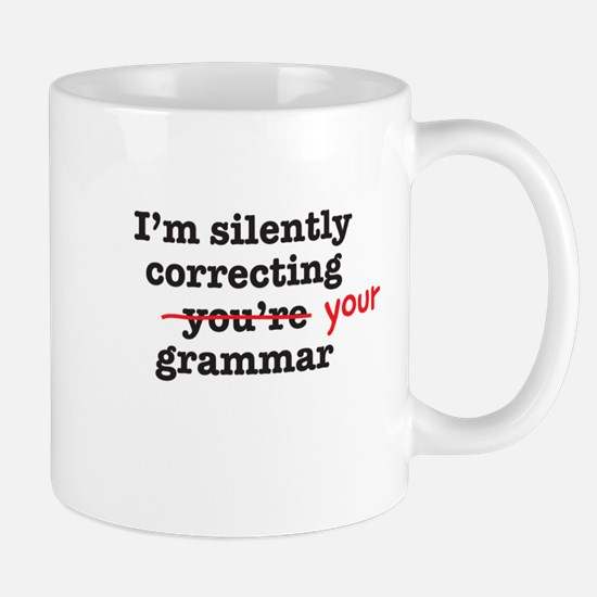 Silently correcting grammar Mugs