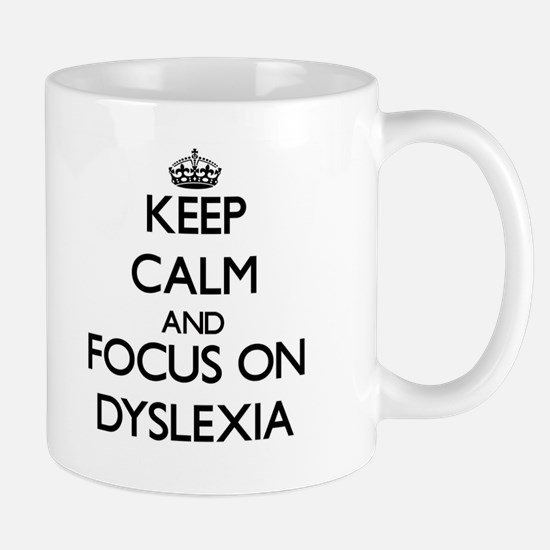 Keep Calm and focus on Dyslexia Mugs