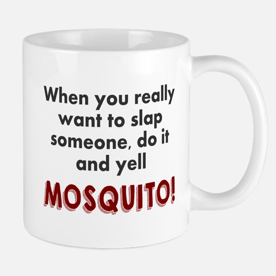 Slap someone mosquito Mug