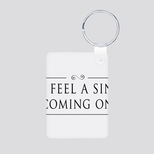I Feel A Sin Coming On Keychains