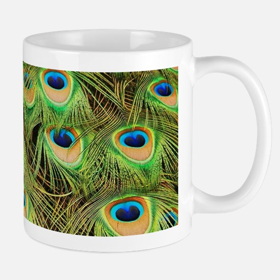 Colorful peacock tail feathers Mugs