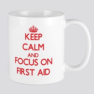 Keep Calm and focus on First Aid Mugs