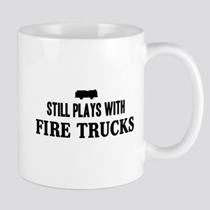 Still plays with fire trucks Mugs