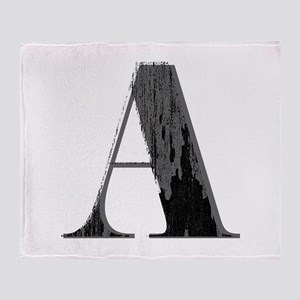 Grungy artistic letter A in black and grey tone Th
