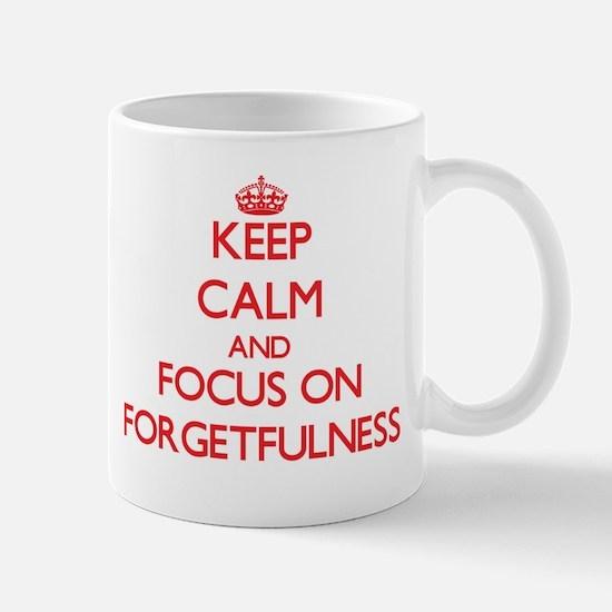Keep Calm and focus on Forgetfulness Mugs