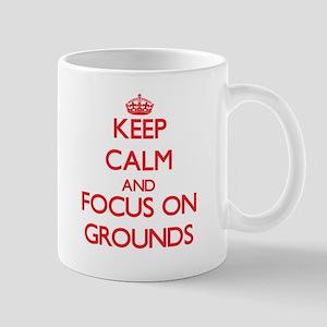 Keep Calm and focus on Grounds Mugs
