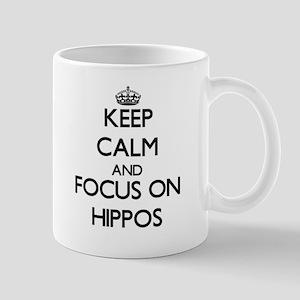 Keep Calm and focus on Hippos Mugs