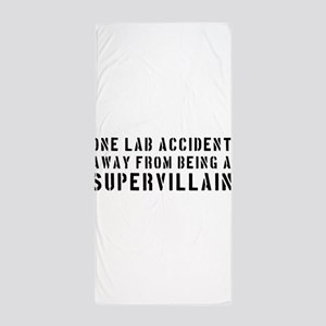 One lab accident supervillain Beach Towel
