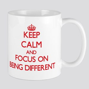 Keep Calm and focus on Being Different Mugs