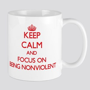 Keep Calm and focus on Being Nonviolent Mugs