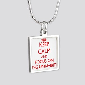 Keep Calm and focus on Being Uninhibited Necklaces