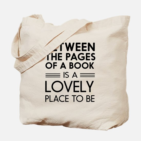 Between pages of book Tote Bag