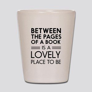 Between pages of book Shot Glass