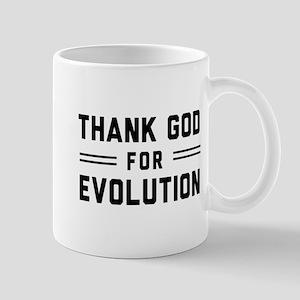 Thank God For Evolution Mugs