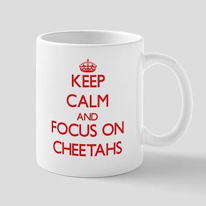 Keep Calm and focus on Cheetahs Mugs