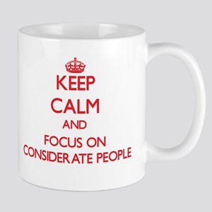Keep Calm and focus on Considerate People Mugs