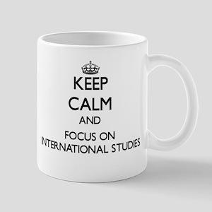 Keep calm and focus on International Studies Mugs