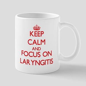 Keep Calm and focus on Laryngitis Mugs