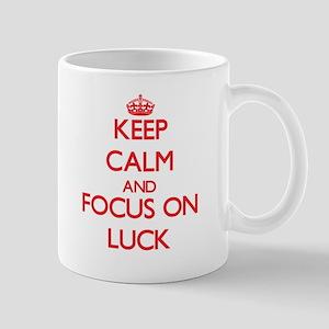 Keep Calm and focus on Luck Mugs