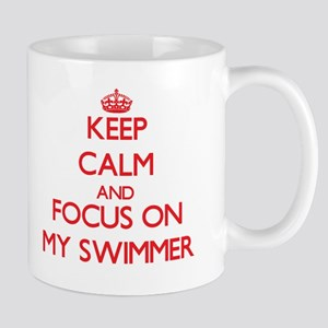 Keep Calm and focus on My Swimmer Mugs