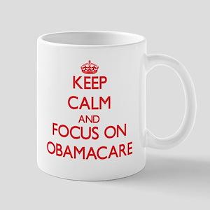 Keep Calm and focus on Obamacare Mugs