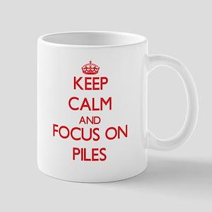 Keep Calm and focus on Piles Mugs