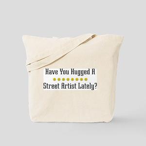 Hugged Street Artist Tote Bag