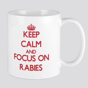 Keep Calm and focus on Rabies Mugs