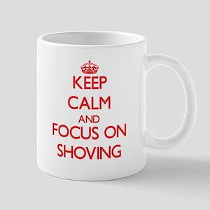 Keep Calm and focus on Shoving Mugs