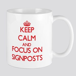 Keep Calm and focus on Signposts Mugs
