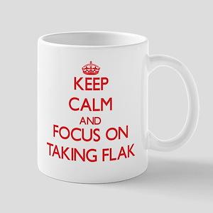 Keep Calm and focus on Taking Flak Mugs