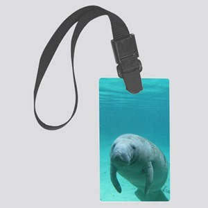Seacow or Manatee Swimming Under Large Luggage Tag