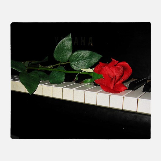 Rose on Piano 2 Throw Blanket