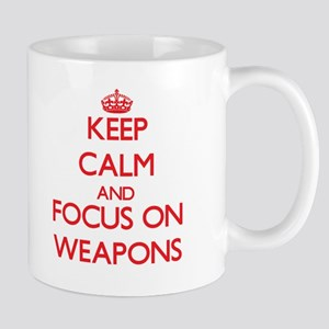 Keep Calm and focus on Weapons Mugs