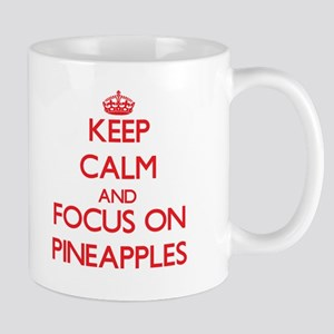 Keep Calm and focus on Pineapples Mugs