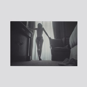 Analog photo of sexy young woman in hotel bedroom