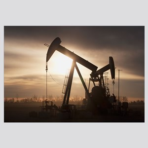 Silhouette Of Two Pump Jacks At Sunrise With Cloud