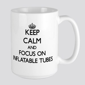 Keep Calm and focus on Inflatable Tubes Mugs
