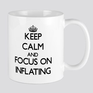 Keep Calm and focus on Inflating Mugs