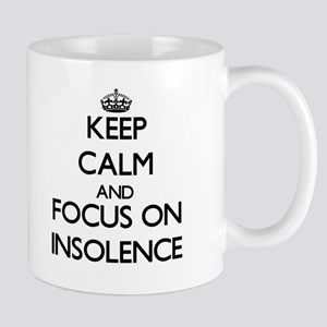 Keep Calm and focus on Insolence Mugs