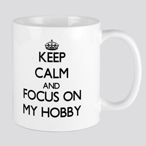 Keep Calm and focus on My Hobby Mugs