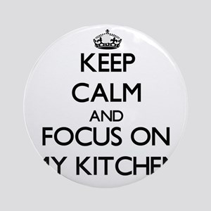 Keep Calm and focus on My Kitchen Ornament (Round)