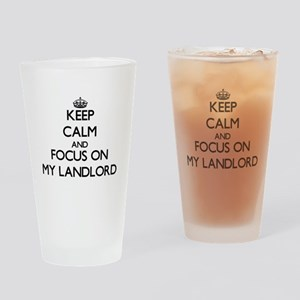 Keep Calm and focus on My Landlord Drinking Glass