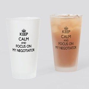 Keep Calm and focus on My Negotiato Drinking Glass