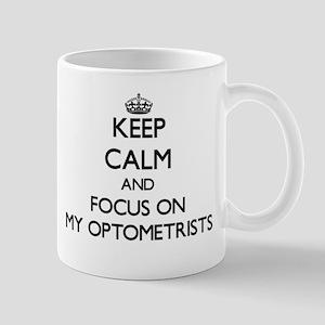 Keep Calm and focus on My Optometrists Mugs